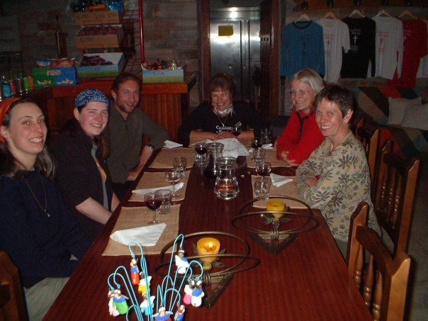Dinner at Albergue do Brasil. Cristina sits at the head of the table.