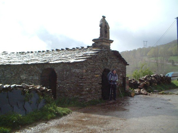The architecture changed along with the landscape: here is Anne outside a typical Galician church, low, grey-stone.