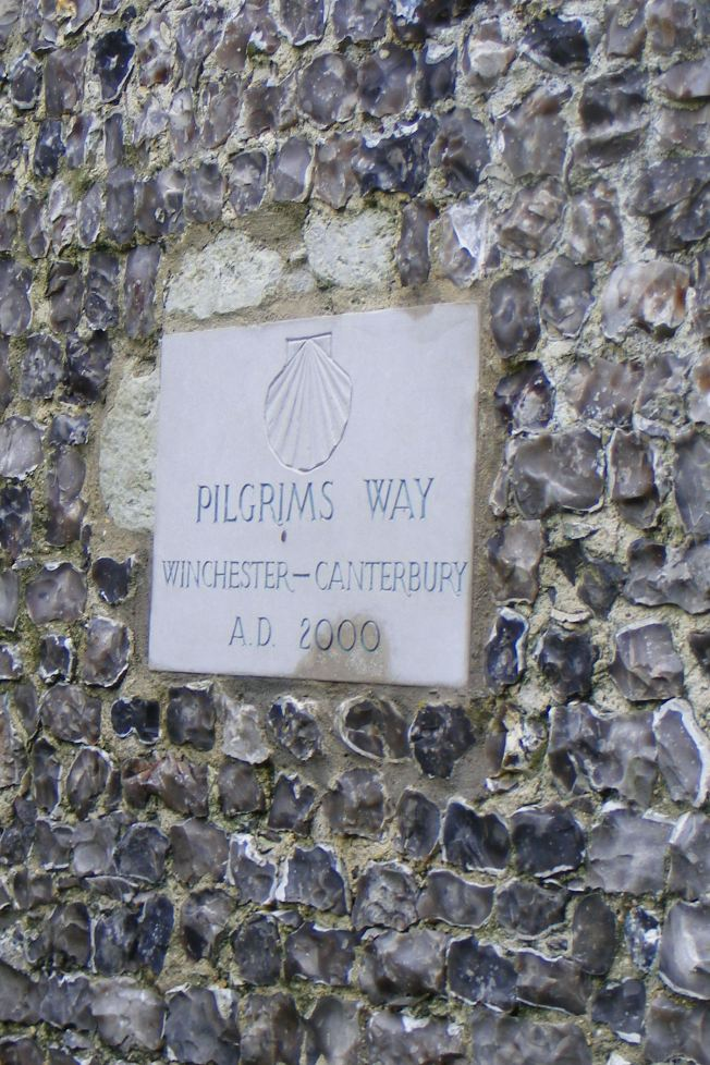 Waymark on the wall of St John the Baptist church, Alresford