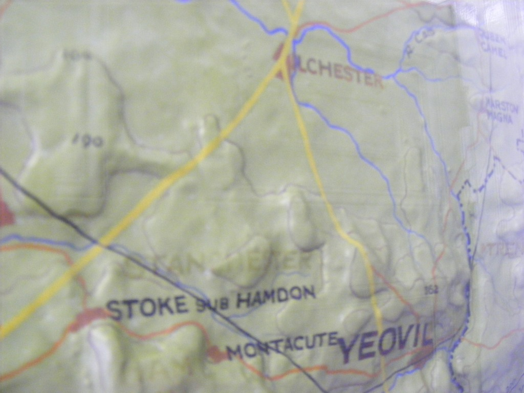 detail of a relief map showing Ilchester at the top, Yeovil at the bottom, and, in faint red type, 'STANCHESTER' a third of the way up