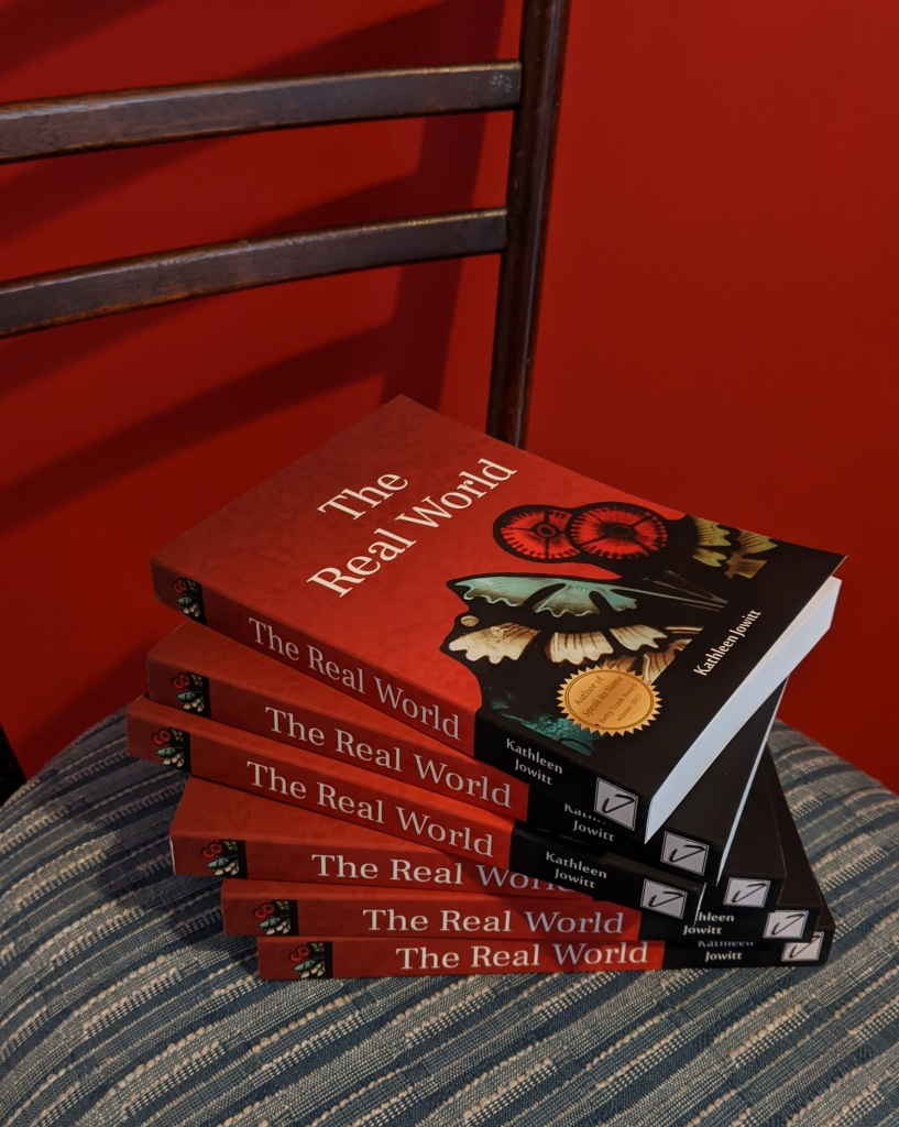 Stack of six paperback copies of 'The Real World'
