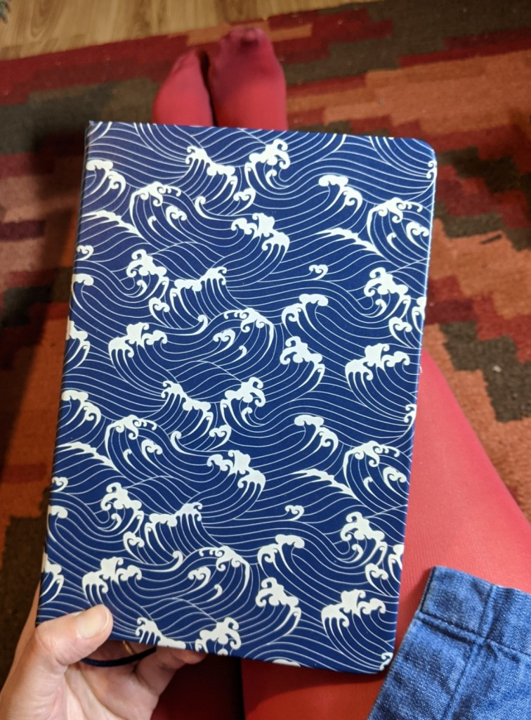 Hardback notebook with a cover pattern of blue and white waves
