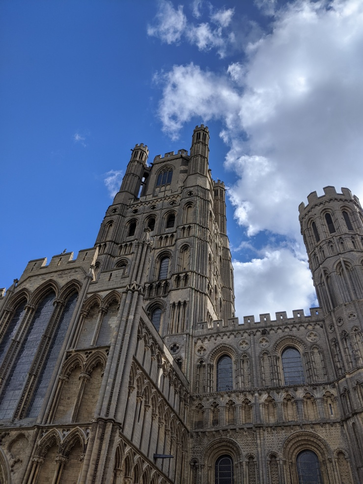 cathedral in grey-yellow stone against a blue sky
