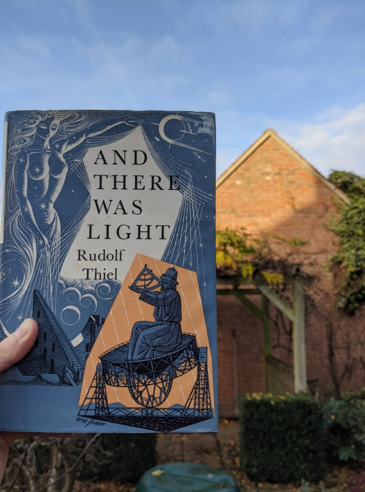 hardback copy of 'And there was light' by Rudolf Thiel held up in front of the same roof as in the first photo, but in daylight)