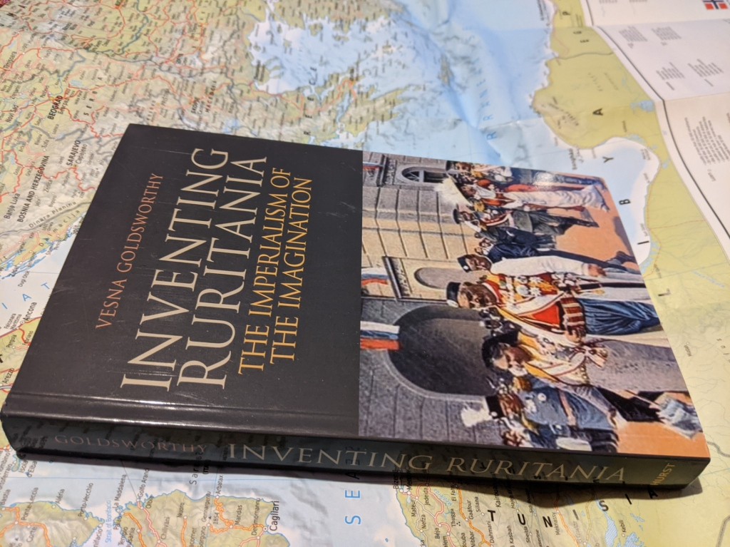 A paperback copy of 'Inventing Ruritania: the imperialism of the imagination' lies on a map of Europe