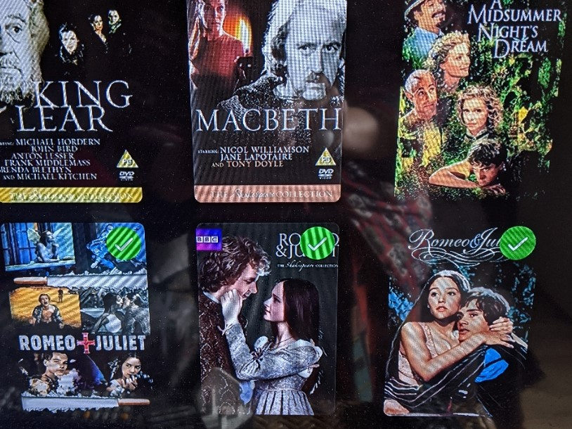 Dark screen showing DVD covers for three different versions of Romeo and Juliet, plus other Shakespeare plays