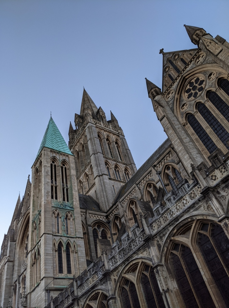 A pointy Victorian Gothic cathedral in grey stone, shot from below.